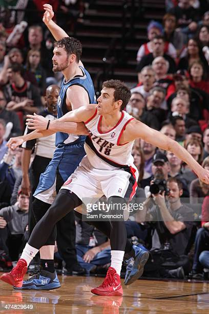 Victor Claver of the Portland Trail Blazers boxes out Kevin Love of the Minnesota Timberwolves on February 23 2014 at the Moda Center Arena in...