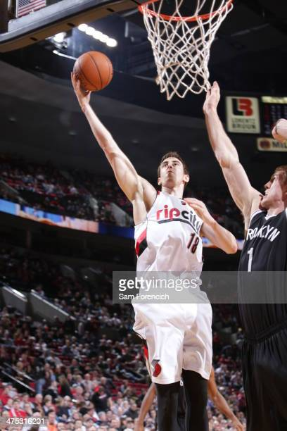 Victor Claver of the Portland Trail Blazers drives to the basket against the Brooklyn Nets on February 26 2014 at the Moda Center Arena in Portland...