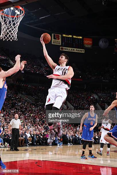Victor Claver of the Portland Trail Blazers goes to the basket against the New York Knicks on December 28 2014 at the Moda Center in Portland Oregon...