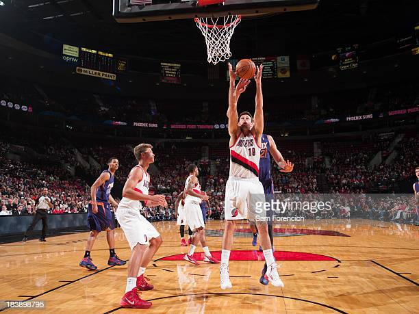 Victor Claver of the Portland Trail Blazers rebounds against the Phoenix Suns on October 9 2013 at the Moda Center Arena in Portland Oregon NOTE TO...