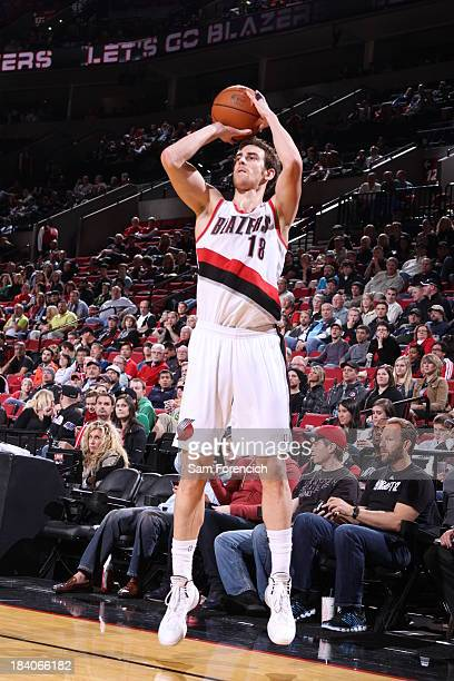 Victor Claver of the Portland Trail Blazers shoots the ball against the Phoenix Suns on October 9 2013 at the Moda Center Arena in Portland Oregon...