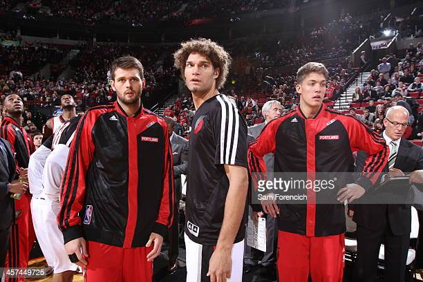 Victor Claver Robin Lopez and Meyers Leonard of the Portland Trail Blazers walk out before the game against the Chicago Bulls on November 22 2013 at...