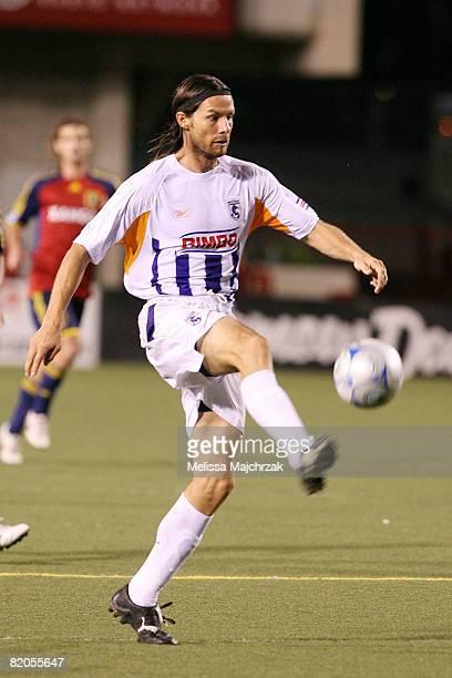 Victor Cordero of Deportivo Saprissa kicks the ball against Real Salt Lake at Rice Eccles Stadium on July 23 2008 in Salt Lake City Utah
