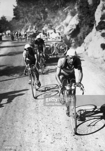 Victor Cosson French cyclist at the head of the peloton with French cyclist Trino Yelamos just behind him as the Tour de France reaches Le Col de...