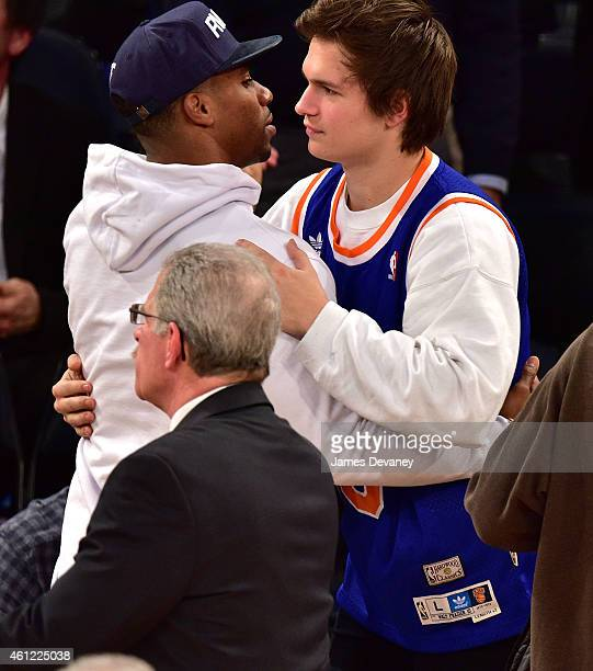 Victor Cruz and Ansel Elgort attend the Houston Rockets vs New York Knicks game at Madison Square Garden on January 8 2015 in New York City