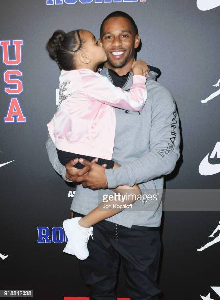 Victor Cruz and daughter attend ROOKIE USA Fashion Show at Milk Studios on February 15 2018 in Hollywood California
