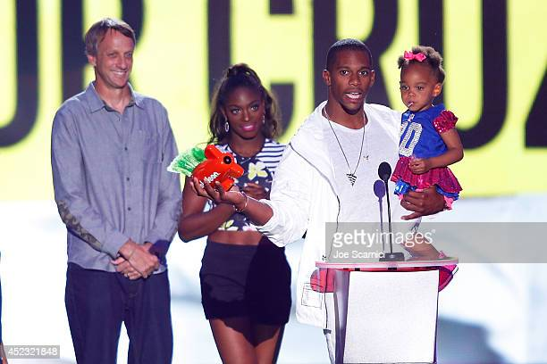 Victor Cruz and daughter Kennedy Cruz speak onstage at Nickelodeon Kids' Choice Sports Awards 2014 at Pauley Pavilion on July 17 2014 in Los Angeles...