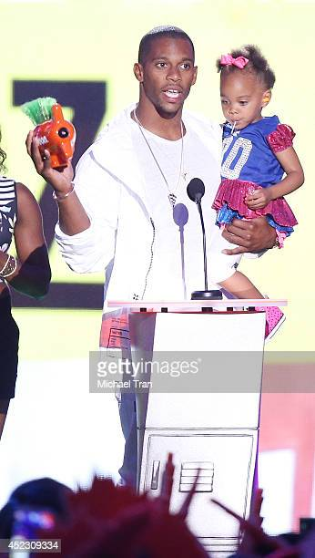 Victor Cruz and daughter Kennedy Cruz speak onstage during the Nickelodeon Kids' Choice Sports Awards 2014 held at Pauley Pavilion on July 17 2014 in...