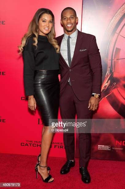 Victor Cruz and Elaina Watley attend the 'Hunger Games Catching Fire' New York Premiere at AMC Lincoln Square Theater on November 20 2013 in New York...