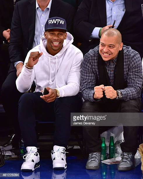 Victor Cruz and guest attend the Houston Rockets vs New York Knicks game at Madison Square Garden on January 8 2015 in New York City
