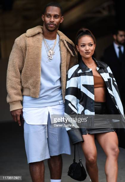 Victor Cruz and Karreuche Tran are seen outside the Phillip Lim show during New York Fashion Week S/S20 on September 09, 2019 in Brooklyn, New York.