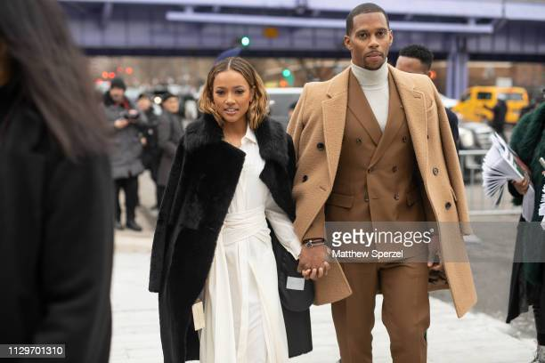 Victor Cruz and Karrueche Tran are seen on the street during New York Fashion Week AW19 wearing BOSS on February 13, 2019 in New York City.