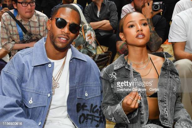 Victor Cruz and Karrueche Tran attend the Off-White Menswear Spring Summer 2020 show as part of Paris Fashion Week on June 19, 2019 in Paris, France.