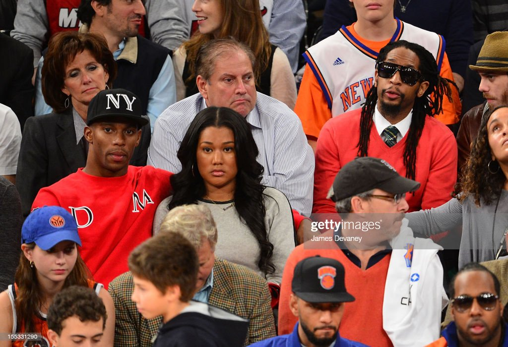 Victor Cruz (L) and Lil Jon (R) attend the Miami Heat vs New York Knicks game at Madison Square Garden on November 2, 2012 in New York City.