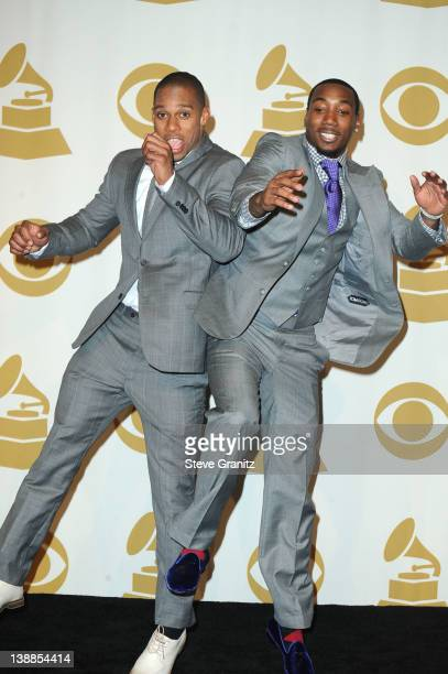 Victor Cruz and Mario Manningham of The New York Giants pose in the Media Center during the 54th Annual GRAMMY Awards at Staples Center on February...