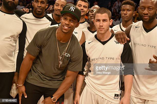 Victor Cruz and Nick Jonas pose with Team Jonas at the Roc Nation Summer Classic Charity Basketball Tournament at Barclays Center of Brooklyn on July...