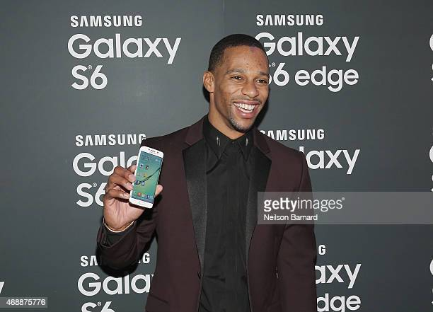 Victor Cruz arrives on the red carpet at the Samsung Galaxy S 6 edge launch in New York City on April 7 2015 in New York City