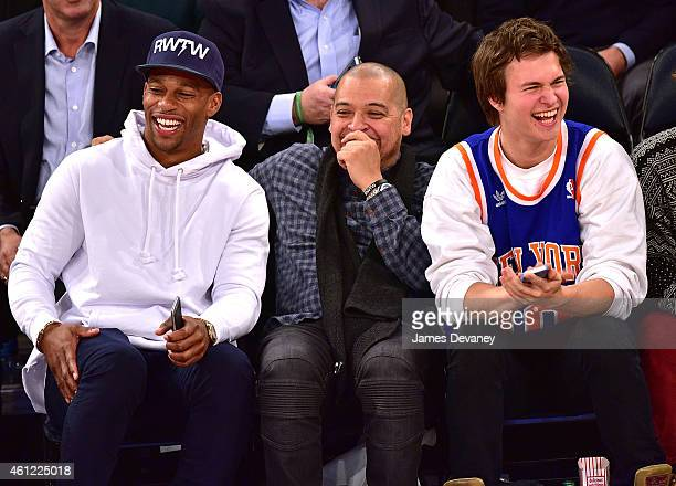 Victor Cruz guest and Ansel Elgort attend the Houston Rockets vs New York Knicks game at Madison Square Garden on January 8 2015 in New York City