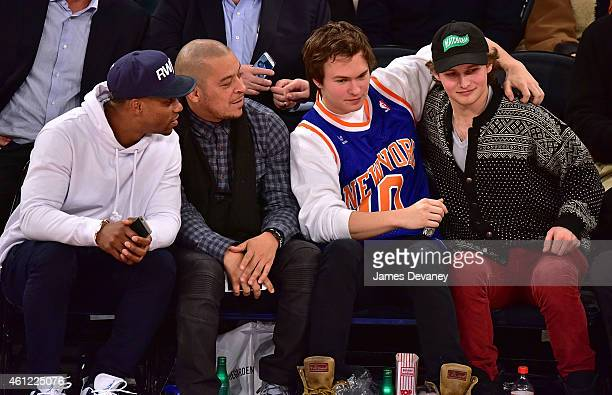 Victor Cruz guest Ansel Elgort and guest attend the Houston Rockets vs New York Knicks game at Madison Square Garden on January 8 2015 in New York...