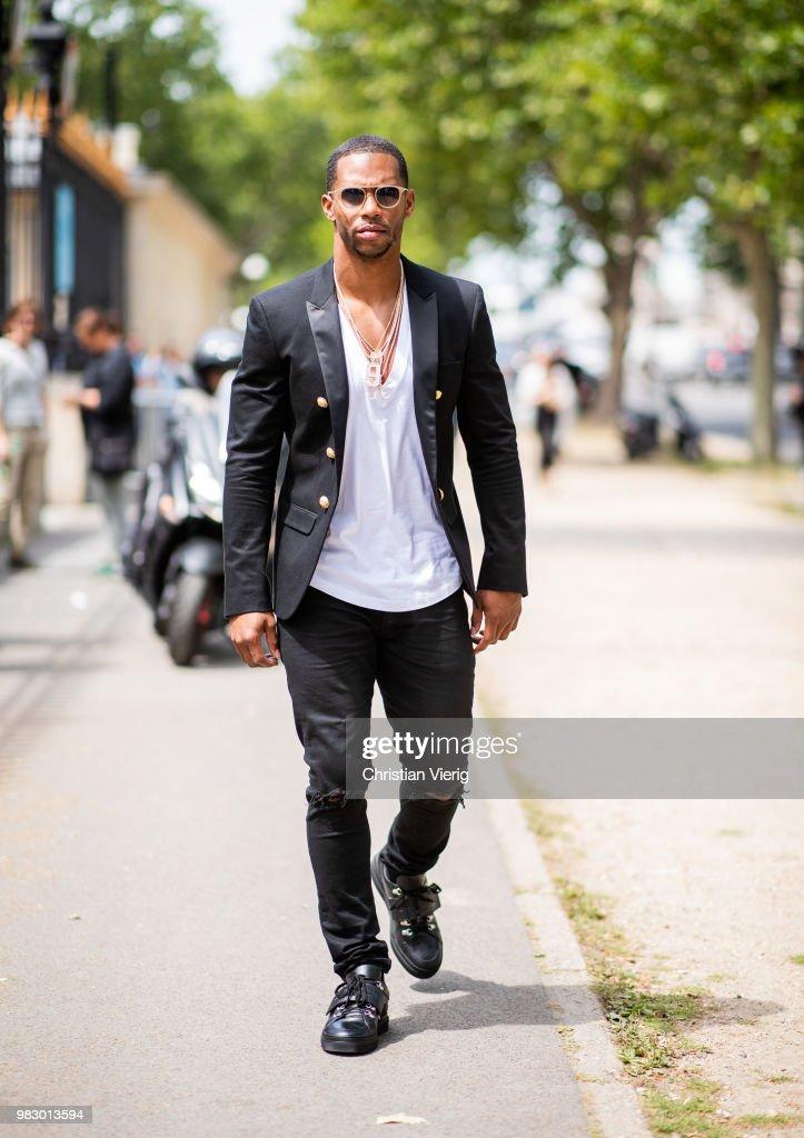 Victor Cruz is seen outside Balmain on day six of Paris Fashion Week Menswear SS19 on June 24, 2018 in Paris, France.