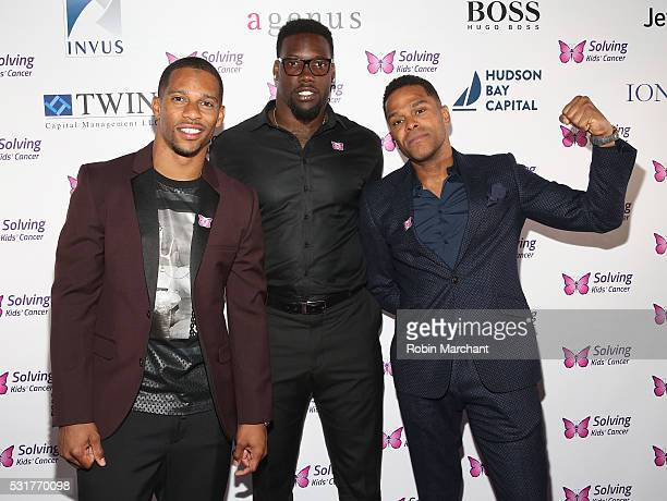 Victor Cruz Jason PierrePaul and Maxwell attends 7th Annual Solving Kids' Cancer Spring Celebration on May 16 2016 in New York New York