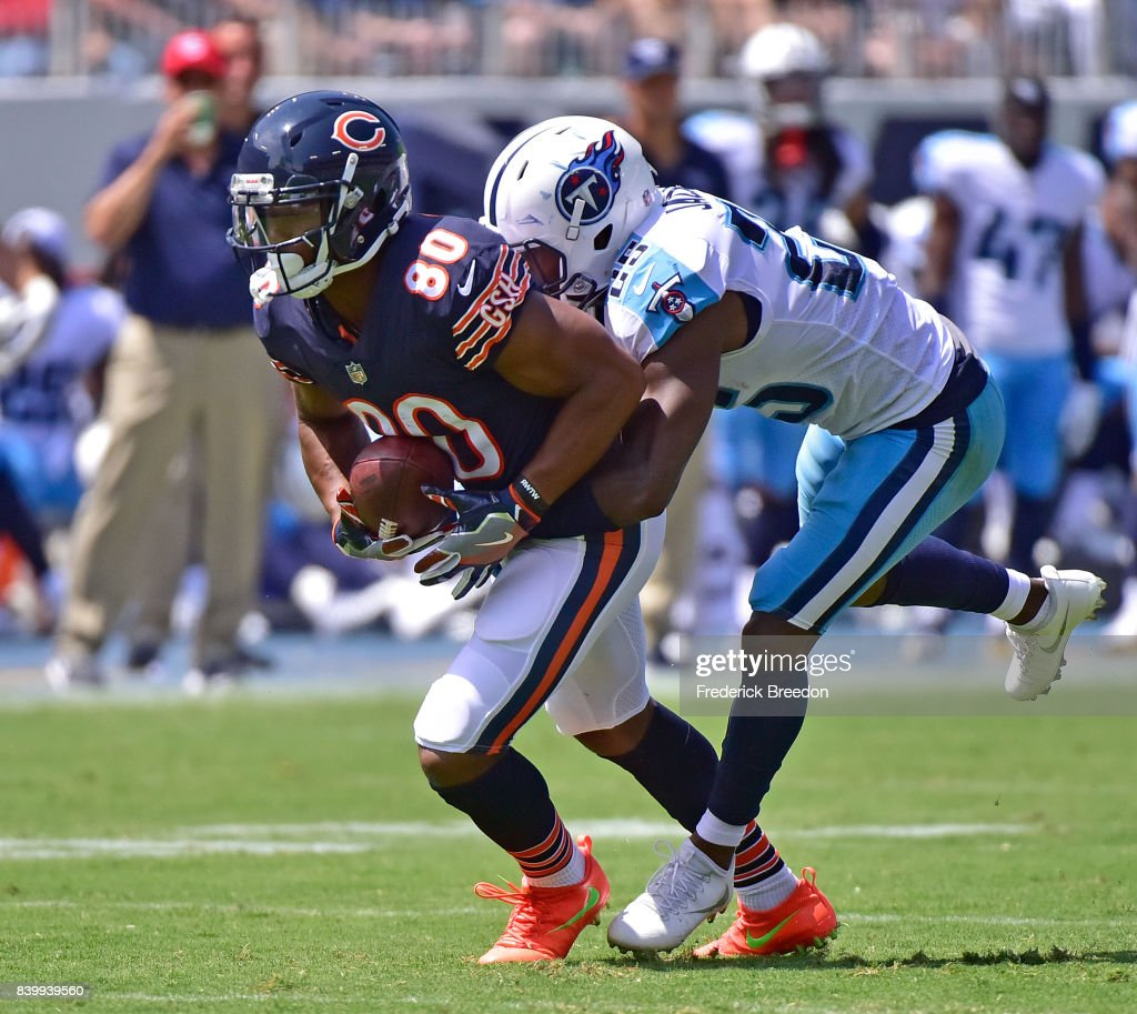 Victor Cruz #80 of the Chicago Bears is tackled by Adoree' Jackson #25 of the Tennessee Titans during the first half at Nissan Stadium on August 27, 2017 in Nashville, Tennessee.