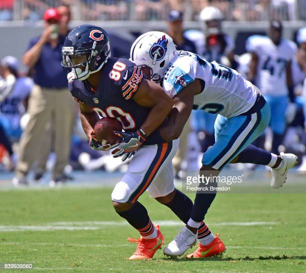Victor Cruz of the Chicago Bears is tackled by Adoree' Jackson of the Tennessee Titans during the first half at Nissan Stadium on August 27 2017 in...