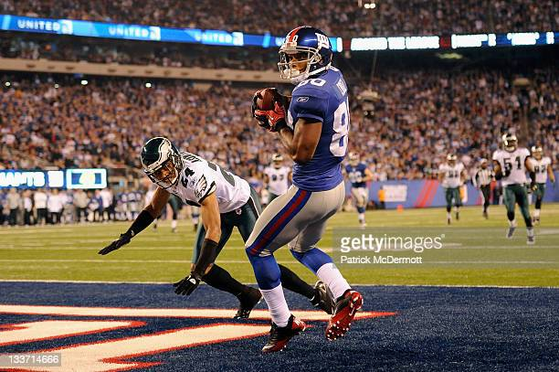 Victor Cruz of the New York Giants catches a 24yard touchdown reception in the fourth quarter against Nnamdi Asomugha of the Philadelphia Eagles at...