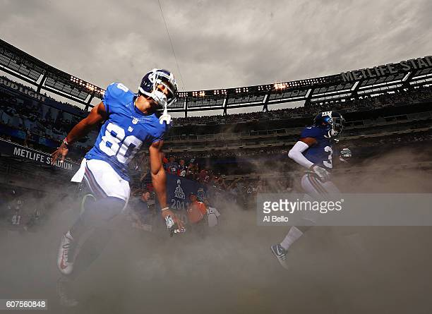 Victor Cruz of the New York Giants enters the field against the New Orleans Saints before their game at MetLife Stadium on September 18, 2016 in East...
