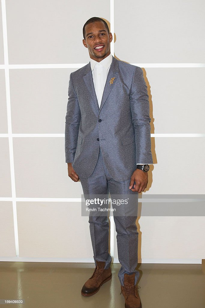 Victor Cruz poses backstage prior to the Calvin Klein Collection show as part of Milan Fashion Week Menswear Autumn/Winter 2013 on January 13, 2013 in Milan, Italy.