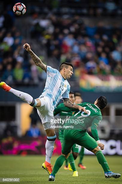 Victor Cuesta of Argentina struggles for the ball against Carmelo Algaraaaz of Bolivia during the 2016 Copa America Centenario Group D match between...