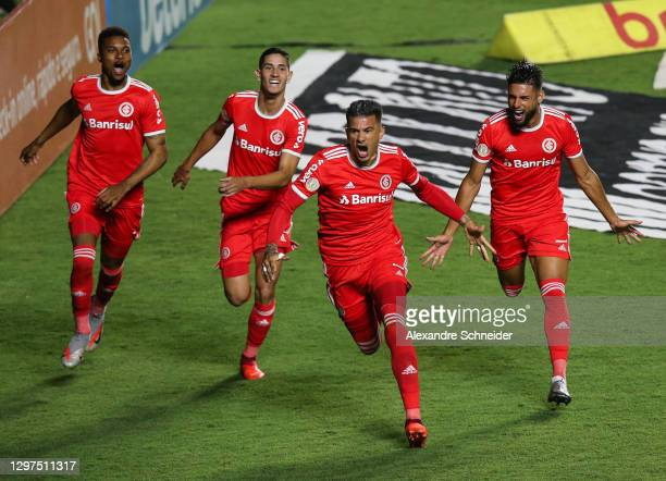Victor Cuesta of Internacional celebrates with his team mates after scoring the first goal of their team during the match against Sao Paulo as part...