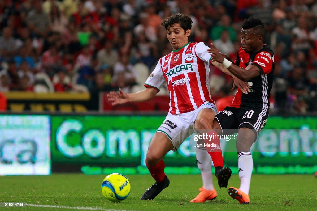 Victor Davila (L) of Necaxa fights for the ball with Clifford Aboagye (R) of Atlas during the 7th round match between Atlas and Necaxa as part of the Torneo Clausura 2018 Liga MX at Jalisco Stadium on February 13, 2018 in Guadalajara, Mexico.