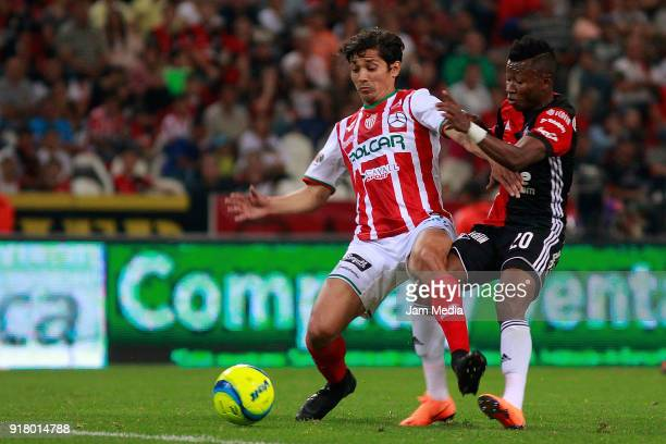 Victor Davila of Necaxa fights for the ball with Clifford Aboagye of Atlas during the 7th round match between Atlas and Necaxa as part of the Torneo...