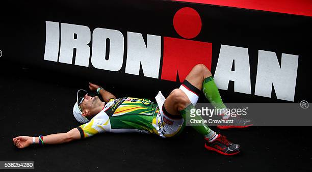 Victor Del Corral of Spain lays down exhausted after he takes first place to win the mens race during the Ironman France on June 05 2016 in Nice...