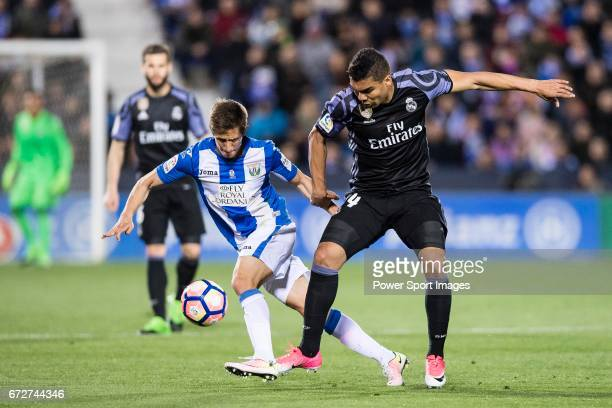 Victor Diaz of Deportivo Leganes battles for the ball with Carlos Henrique Casemiro of Real Madrid during their La Liga match between Deportivo...