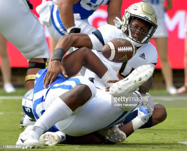 Victor Dimukeje of the Duke Blue Devils forced a fumble by James Graham of the Georgia Tech Yellow Jackets during the first half of their game at...