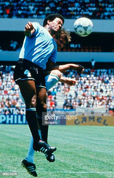 Victor Diogo of Uruguay and Norbert Eder of Germany in action during the World Cup match between Uruguay and Germany on June 04 1986 in Queretaro...