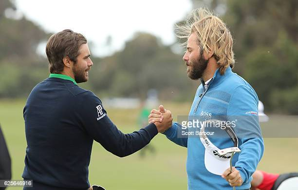 Victor Dubuisson and Romain Langasque of France celebrate after finishing their round during day two of the World Cup of Golf at Kingston Heath Golf...
