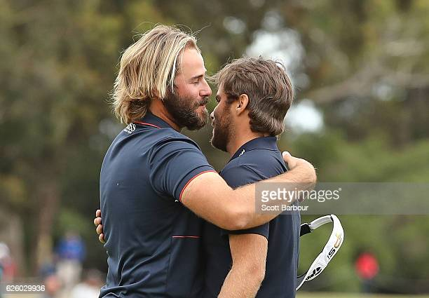 Victor Dubuisson and Romain Langasque of France embrace after finishing their round during day four of the World Cup of Golf at Kingston Heath Golf...