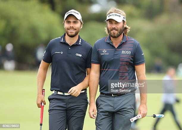 Victor Dubuisson and Romain Langasque of France walk up to the 18th hole during day four of the World Cup of Golf at Kingston Heath Golf Club on...