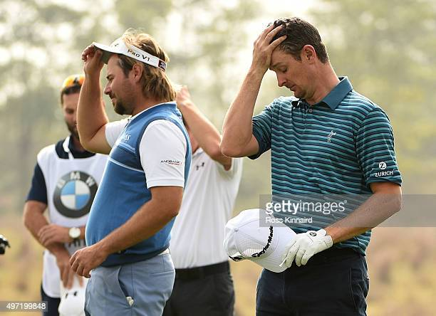Victor Dubuisson of France and Justin Rose of England stand for a minutes silence as a mark of respect for those killed in the Paris bombings during...