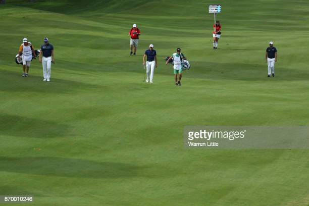 Victor Dubuisson of France Benjamin Hebert of France and Matt Wallace of England walk down the 11th hole during the third round of the Turkish...