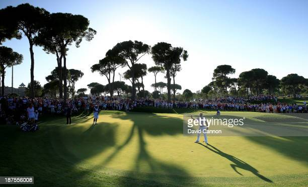 Victor Dubuisson of France celebrates after holing his birdie putt at the par 5 18th hole to finish on a total of 24 under par and a two stroke...