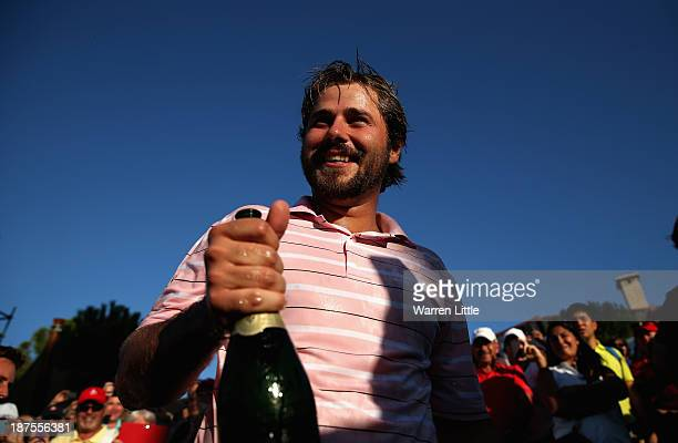 Victor Dubuisson of France drimls champagne after winning the 2013 Turkish Airlines Open on the Montgomerie Maxx Royal Course on a score 24 under par...