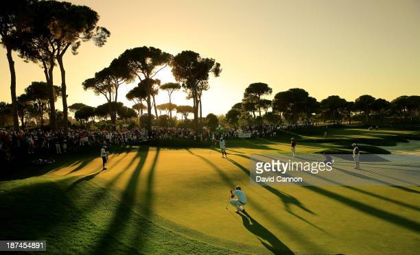 Victor Dubuisson of France in the foreground the third round leader lines up an eagle putt on the par 5 18th green during the third round of the 2013...
