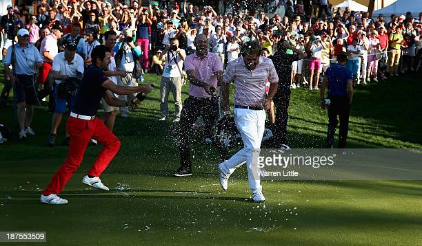 Victor Dubuisson of France is congratulated by his fellow French Tour professionals after winning the 2013 Turkish Airlines Open on the Montgomerie...