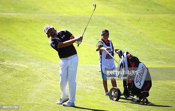 Victor Dubuisson of France plays a shot from the 4th fairway during a practice round ahead of the DD Real Czech Masters at Albatross Golf Resort on...
