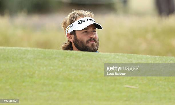 Victor Dubuisson of France plays a shot out of a bunker during day two of the World Cup of Golf at Kingston Heath Golf Club on November 25 2016 in...
