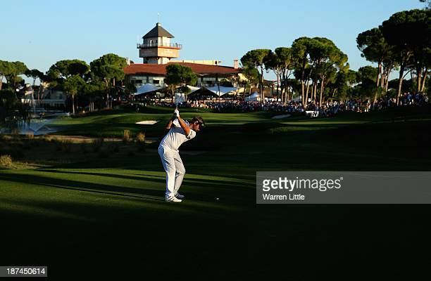 Victor Dubuisson of France plays his second shot into the 18th green during the third round of the Turkish Airlines Open at The Montgomerie Maxx...